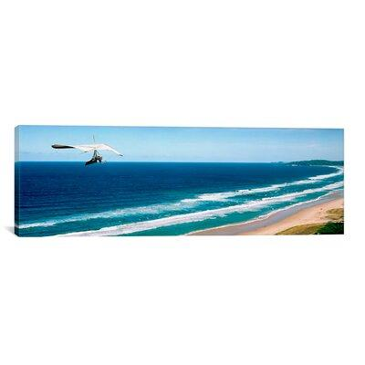 East Urban Home 'Hang Glider Over the Sea' Photographic P...